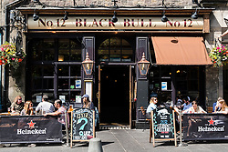 Busy Black Bull pub in Grassmarket district of Edinburgh , Scotland, United Kingdom