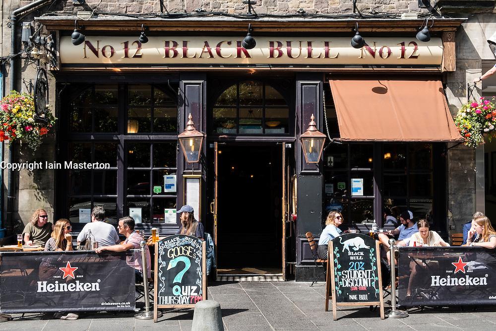 Busy Black Bull pub in Grassmarket district of Edinburgh , Scotland, United Kingdom