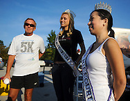 29 SEPT. 2012 -- BALLWIN, Mo. -- Adelaida Peterson (right), Mrs. Missouri International 2013, joins Katie Kearney, MIss Missouri USA 2012 and Pat Bradley, founder of the charity International Crisis Aid, before the start of a 5K run / walk fundraiser for the organization at Queeny Park in Ballwin, Mo. Saturday, Sept. 29, 2012. Peterson, a parishioner at Incarnate Word Parish in Chesterfield, is an advocate on the issue of human trafficking. Photo © copyright 2012 Sid Hastings.
