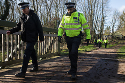 Denham, UK. 11 February, 2020. Thames Valley Police officers arrive to arrest an environmental activist from Extinction Rebellion who had been 'slow walking' in front of a large truck delivering a JCB forklift truck to a HS2 site. Contractors working on behalf of HS2 are rerouting electricity pylons through a Site of Metropolitan Importance for Nature Conservation (SMI) in conjunction with the high-speed rail link.