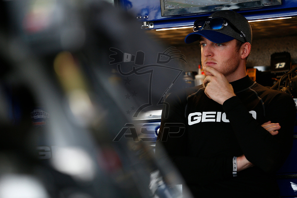 Ty Dillon (13) hangs out in the garage during practice for the Gander Outdoors 400 at Dover International Speedway in Dover, Delaware.