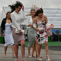 National Hunt Horse Racing - 2019 Randox Health Grand National Festival - Friday, Day Two (Ladies Day)<br /> <br /> Female racegoers arrive for Ladies Day on a windy day <br /> at Aintree Racecourse.<br /> <br /> COLORSPORT/WINSTON BYNORTH