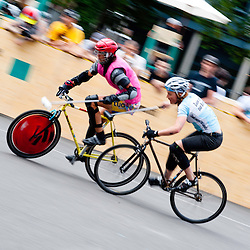 London, UK - 24 August 2012: two players chase the ball during the Hell's Belles Vol 2, Ladies Bike Polo Tournament in Bethnal Green Gardens.