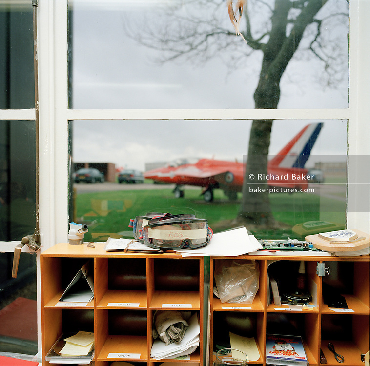 Engineering room and old Gnat jet of the Red Arrows, Britain's RAF aerobatic team.