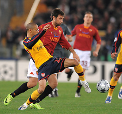 Gael Clichy and Mirko Vucinic compete for the ball during the UEFA Champions League, Round of Last 16, Second Leg match between AS Roma and Arsenal at the Stadio Olimpico on March 11, 2009 in Rome, Italy.