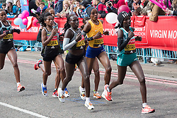 © Licensed to London News Pictures. 24/04/2016. London, UK. Leading elite women, including Kenya's Jemima Sumgong run over Tower Bridge at the halfway point of the 2016 London Marathon.  Photo credit : Vickie Flores/LNP