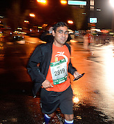 Runner Saurabh Srivastava, of Marietta, starts near the back of the Publix Georgia Marathon in a steady rain on Sunday, March 22, 2015, in Atlanta. David Tulis / AJC Special