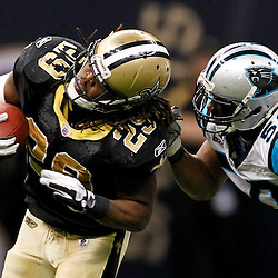 January 1, 2012; New Orleans, LA, USA; New Orleans Saints running back Chris Ivory (29) is grabbed by the hair by Carolina Panthers linebacker James Anderson (50) during the fourth quarter of a game at the Mercedes-Benz Superdome. The Saints defeated the Panthers 45-17. Mandatory Credit: Derick E. Hingle-US PRESSWIRE