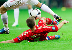 Igor Denisov of Russia under Artur Sobiech of Poland during the UEFA EURO 2012 group A match between Poland and Russia at The National Stadium on June 12, 2012 in Warsaw, Poland.  (Photo by Vid Ponikvar / Sportida.com)