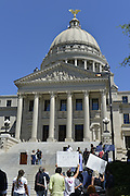4/7/16 Jackson,MS. Mississippi is experiencing backlash from Governor Bryant signing the Religious Freedom bill HB1523 into law Tuesday April 5, 2016.  Protestors voice their reaction and opposition outside the Mississippi State Capitol. Pictured is Todd Allen from Coop Jackson caring a freedom flag and a No Hate in Our State sign. Photo ©Suzi Altman