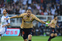 Lyon's Karim Benzema celebrates his first goal during the french first league soccer match, French First League soccer match, Association de la Jeunesse Auxerroise vs Olympique Lyonnais at the Abbe Deschamps stadium in Auxerre. Lyon wrapped up their seventh straight French championship on Saturday with a 3-1 win at Auxerre. Photo by Steeve McMay/Cameleon/ABACAPRESS.COM