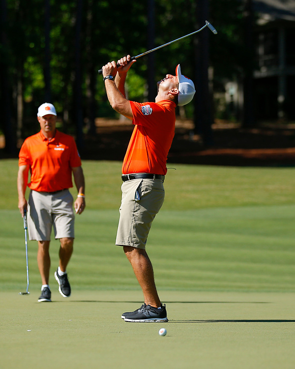 Clemson  head football coach Dabo Swinney reacts after a close putt during the Chick-fil-A Peach Bowl Challenge at the Ritz Carlton Reynolds, Lake Oconee, on Monday, April 30, 2019, in Greensboro, GA. (Paul Abell via Abell Images for Chick-fil-A Peach Bowl Challenge)