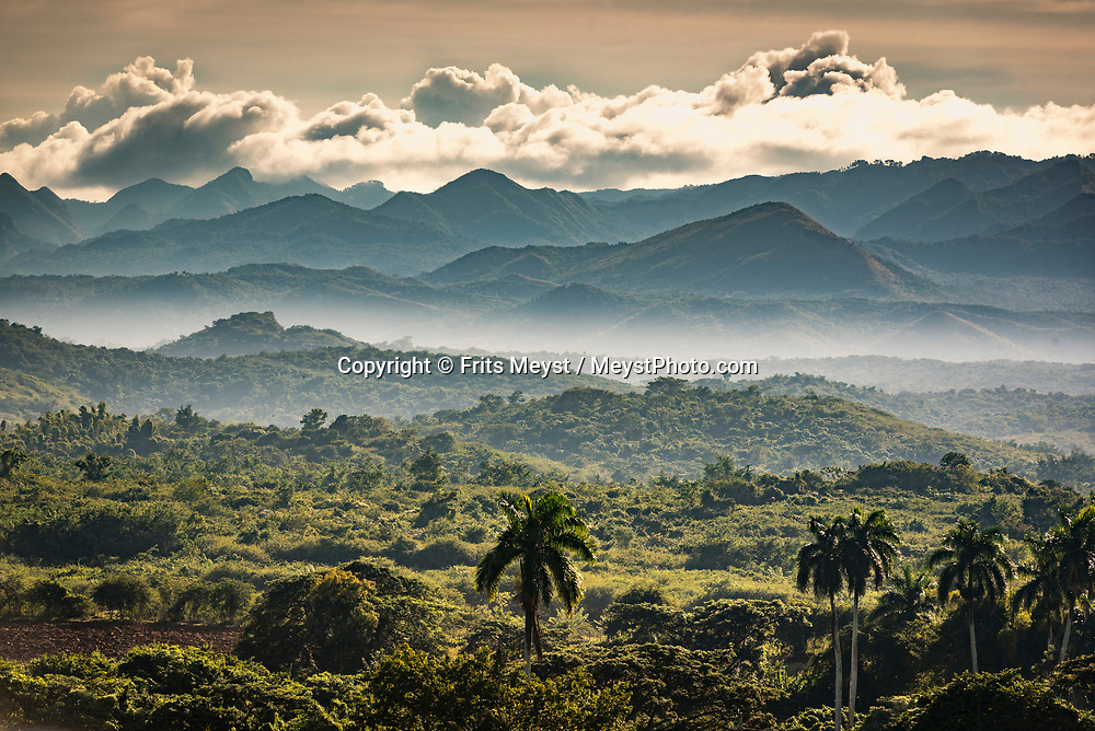 Trinidad, Cuba, November 2018. Just outside Trinidad sits a massive nature preserve, Topes de Collantes. The park is full of hiking opportunities and waterfalls to explore. Cuba is a Caribbean island nation under communist rule. It has sugar-white beaches and is dotted with tobacco fields, which play a part in the production of the country's legendary cigars. The capital, Havana, is lined with pastel houses, 1950s-era cars and Spanish-colonial architecture in the 16th-century core. Photo by Frits Meyst / MeystPhoto.com