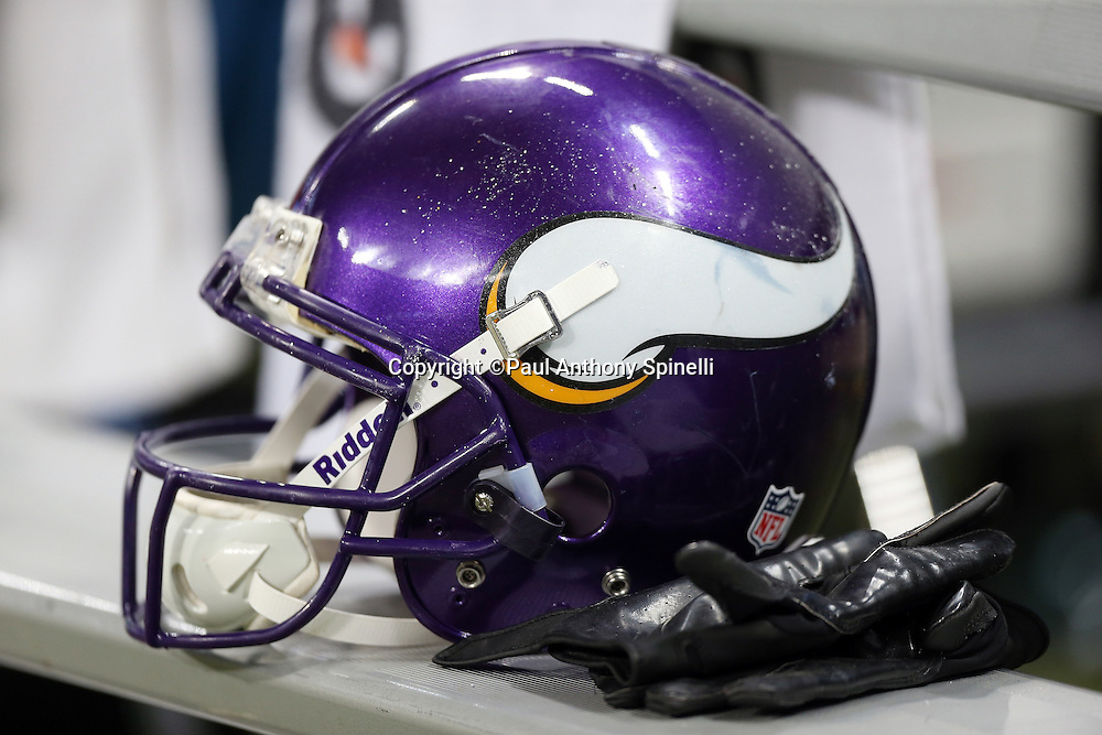 A Minnesota Vikings helmet and gloves sit on the sideline bench during halftime of the NFL week 15 football game against the St. Louis Rams on Sunday, Dec. 16, 2012 in St. Louis. The Vikings won the game 36-22. ©Paul Anthony Spinelli