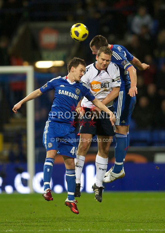 BOLTON, ENGLAND - Monday, January 24, 2011: Chelsea's Josh McEachran and captain John Terry challenge Bolton Wanderers' captain Kevin Davies during the Premiership match at the Reebok Stadium. (Photo by David Rawcliffe/Propaganda)