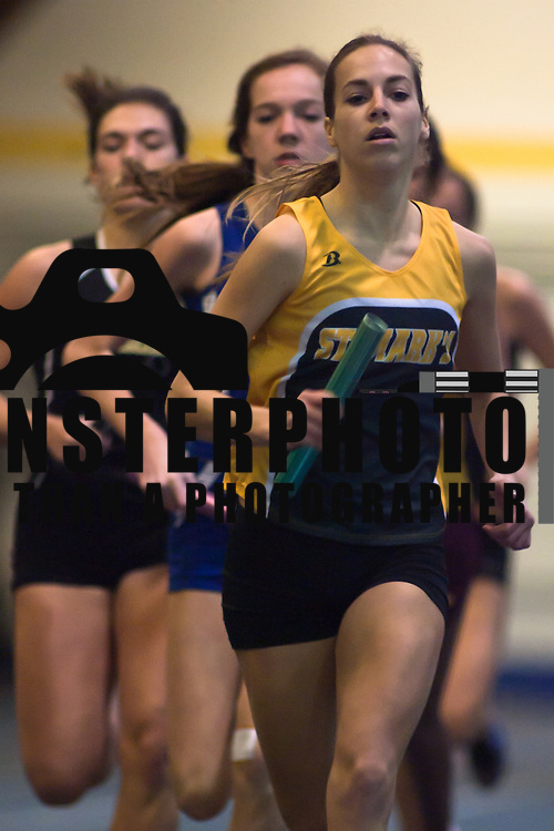 021211 Newark DE: St. Mark's Junior Danielle Wegrzyn leads the pack in the 3200 Meter run at the state indoor track and field championships at The University of Delaware Field House in Newark Delaware Saturday afternoon...Special to The News Journal/SAQUAN STIMPSON