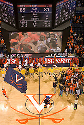 Fans and players celebrate after the Virginia Cavaliers defeated the #12 ranked Clemson Tigers in overtime 85-81 at the John Paul Jones Arena on the Grounds of the University of Virginia in Charlottesville, VA on February 15, 2009.