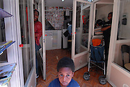 Roma, 22/04/2006: Videoteca e phone center nel quartiere Esquilino, madre africana con bambino - Video library and phone center in the Esquilino, African mother with child.©Andrea Sabbadini