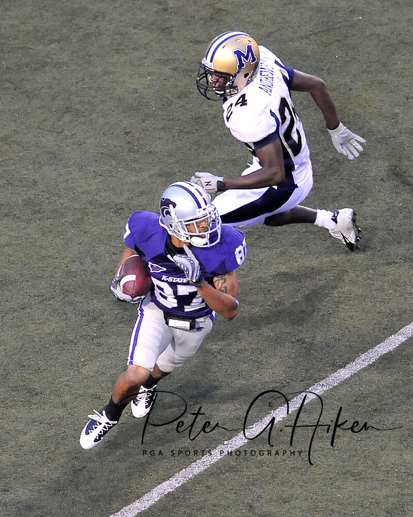 MANHATTAN, KS - SEPTEMBER 06:  Wide receiver Deon Murphy #87 of the Kansas State Wildcats rushes up field in the second quarter past defensive back James Andrews #24 of the Montana State Bobcats on September 6, 2008 at Bill Snyder Family Stadium in Manhattan, Kansas.  Kansas State won 69-10.