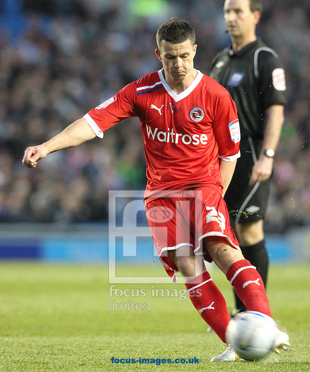 Picture by Paul Terry/Focus Images Ltd. 07545642257.10/04/12.Ian Harte of Reading scores the first goal from a free kick during the Npower Championship match at The American Express Community Stadium, Brighton.