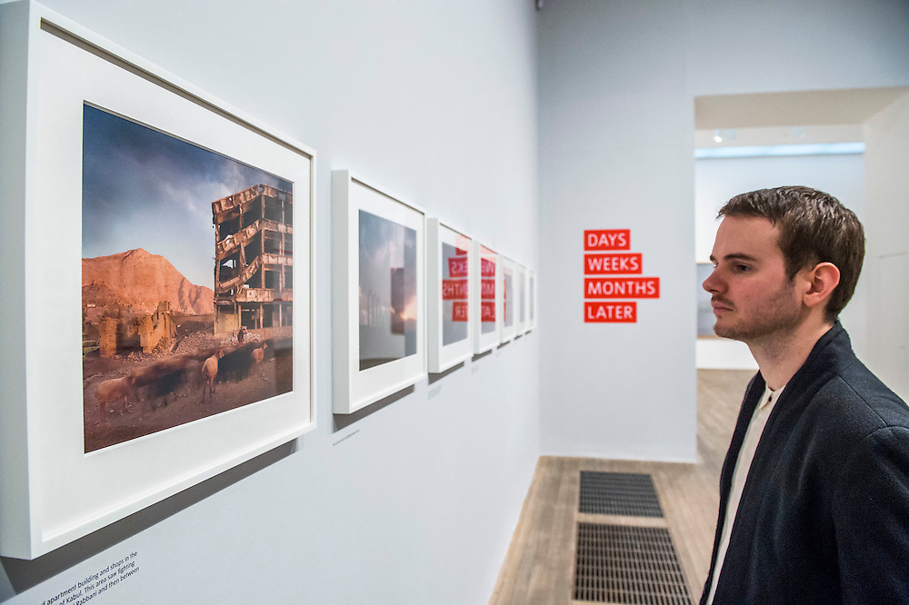 Simon Norfolk's images. Conflict, Time, Photography, a new exhibition at the Tate Modern - showcasing the unique ways photographers look back at moments of conflict, from the seconds after a bomb is detonated to 100 years after a war has ended. It includes: renowned photographers Don McCullin, Kikuji Kawada and Taryn Simon; Luc Delahaye's large-scale image of the US bombing of Taliban positions in Afghanistan, showing a cloud of smoke rising from the battlefield; Hiromi Tsuchida's large-scale photograph of a watch stopped at the moment the atomic bomb fell on Hiroshima in 1945; The Archive of Modern Conflict's colourful and chaotic new installation, bringing together war-related images and objects from around the world and across the past 100 years; and Chloe Dewe Mathews's haunting landscapes photographed at dawn, showing the places where British soldiers were executed for desertion and cowardice in the First World War. The show runs from 26 November 2014 – 15 March 2015. Tate Modern, London, UK 25 Nov 2014.