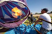 Ground crew preparing a hot air balloon before takeoff