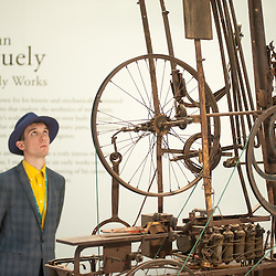 London, UK - 15 October 2014: a man looks at 'La Tour (Berner Zytglogge) 1960' by Jean Tinguely during the first day of Frieze Art Fair and Frieze Masters in Regent's Park.