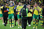 Norwich City midfielder Kenny McLean (23) leads the celebrations after the EFL Sky Bet Championship match between Norwich City and Blackburn Rovers at Carrow Road, Norwich, England on 27 April 2019.