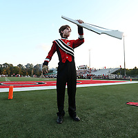Adam Robison | BUY AT PHOTOS.DJOURNAL.COM<br /> Jacob Nunley, a member of the weapon line in the Corinth band, practices his rifle toss prior to Corinth's game against Kossuth Friday night.