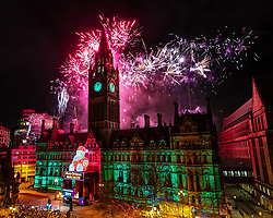 © Licensed to London News Pictures . 01/01/2019. Manchester, UK. Thousands watch as Manchester celebrates the start of 2019 , with a fireworks display in front of the Town Hall in Albert Square . This will be the last year the event takes place in front of the Alfred Waterhouse designed Victorian Gothic Revival building , as extensive refurbishment work is set to close off the building and square for at least five years . Photo credit: Joel Goodman/LNP