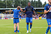 Mascot, AFC Wimbledon attacker Michael Folivi (17) during the EFL Sky Bet League 1 match between AFC Wimbledon and Rotherham United at the Cherry Red Records Stadium, Kingston, England on 3 August 2019.