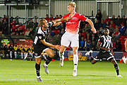Salford City midfielder Tom Walker challenged by the opponent during the EFL Sky Bet League 2 match between Salford City and Grimsby Town FC at Moor Lane, Salford, United Kingdom on 17 September 2019.