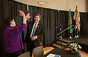Gonzaga President Thayne McCulloh and University of Washington President Ana Mari Cauce high five after announcing a new partnership for medical education and research between the two schools. (Photo by Rajah Bose)