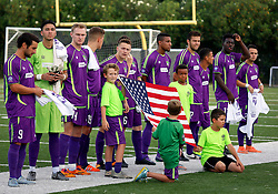 12 July 2016. New Orleans, Louisiana.<br /> NPSL Soccer, Pan American Stadium.<br /> New Orleans Jesters before the kick off against the UANL Tigres from Monterrey, Mexico. <br /> Jesters draw 1-1 at full time, going on to lose the penalty shoot out.<br /> Photo; Charlie Varley/varleypix.com