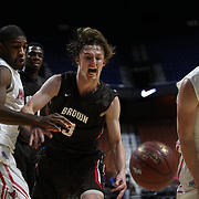 Steven Spieth, Brown, challenges for the rebound with K.J. Lee, (left) and Kristinn Palsson, (right), Marist, during the Marist vs Brown Men's College Basketball game in the Hall of Fame Shootout Tournament at Mohegan Sun Arena, Uncasville, Connecticut, USA. 22nd December 2015. Photo Tim Clayton