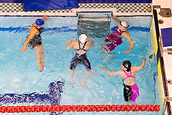 Swimmers exiting the pool  at 2015 IPC Swimming World Championships -  Women's 100m Breastroke SB4