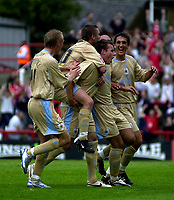 Photo: Catrine Gapper.<br /> Brentford v Bristol City. Coca Cola League 1.<br /> 24/09/2005.<br /> Luke Wilkshire being congratulated by team mates on scoring second goal for Bristol City following free kick.