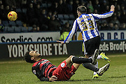 James Perch (QPR) lands having gone over the back of Ross Wallace (Sheffield Wednesday) during the Sky Bet Championship match between Sheffield Wednesday and Queens Park Rangers at Hillsborough, Sheffield, England on 23 February 2016. Photo by Mark P Doherty.