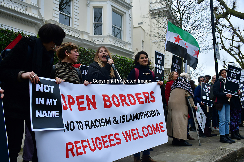 """Protests of Fortress Europe outside the Greek Embassy. When Turkey releses refugees into Greece.  The Europe put up Fortress Europe perventing refugees, in Fact Greece is a scapegoat by the """"War on Terror"""" becomes the biggest refugees camps in Europe. The Five Eye and NATO  should share the responsiblity they cause the refugees to flees on 7 March 2020, London, UK."""