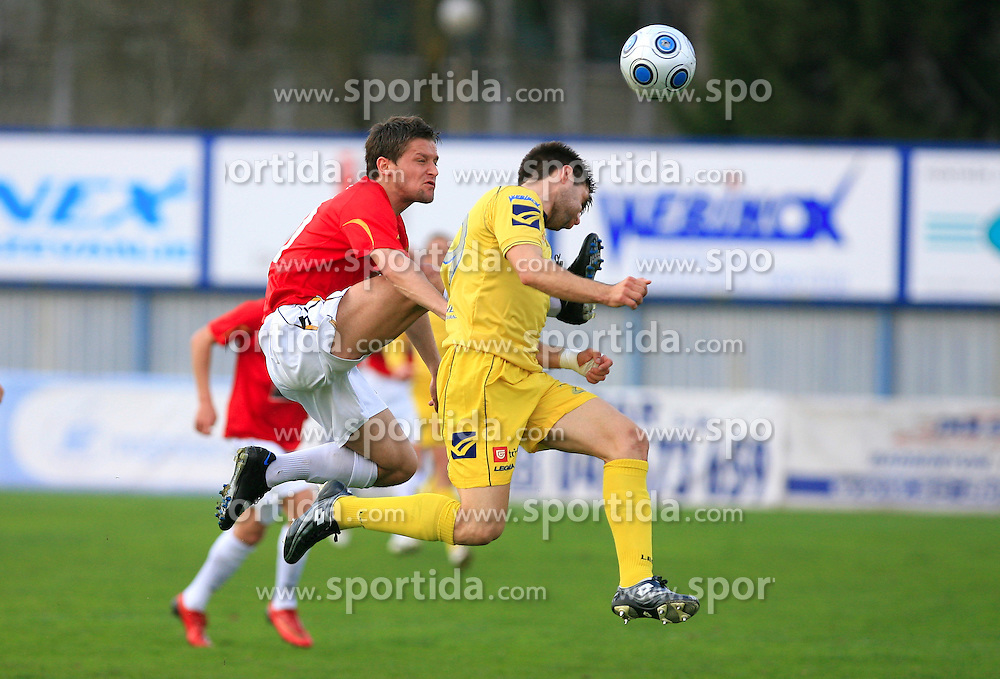 Denis Grbic of Rudar vs Luka Elsner of Domzale at 26th Round of Slovenian First League football match between NK Domzale and NK Rudar Velenje in Sports park Domzale, on April 4, 2009, in Domzale, Slovenia. (Photo by Vid Ponikvar / Sportida)