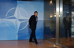 BRUSSELS, BELGIUM - FEB-22-2005 - NATO Secretary General Mr. Jaap de Hoop Scheffer waits to receive the heads of state and government from the 26 NATO countries as they arrive at Alliance Headquarters in Brussels on 22 February for a discussion on transatlantic issues at the  highest level.