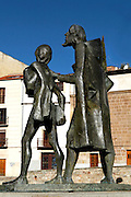 """View from the side of statue of Lazarillo de Tormes leading the blind man, Salamanca, Spain, pictured on December 18, 2010 in the afternoon. The novella, Lazarillo de Tormes, published anonymously in 1554, is credited with the founding of the picaresque literary genre. Salamanca, an important Spanish University city, is known as La Ciudad Dorada (""""The golden city"""") because of the unique golden colour of its Renaissance sandstone buildings. Founded in 1218 its University is still one of the most important in Spain. Around it the Old Town is a UNESCO World Heritage Site. Picture by Manuel Cohen"""