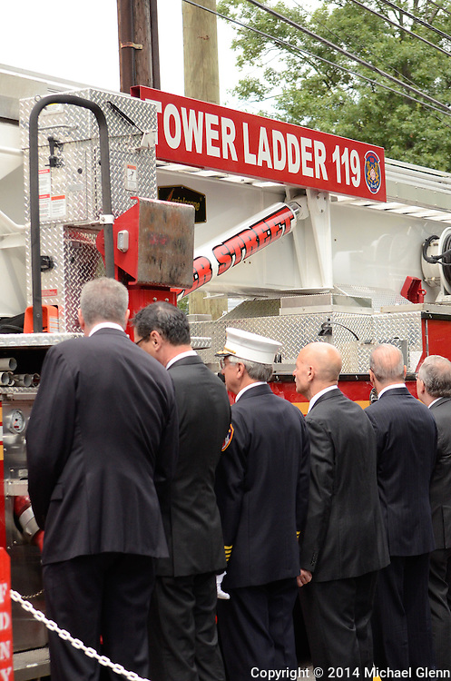 Staten Island, New York - July 10: Tower Ladder 119 moves past city leaders at the Funeral of Lt Gordon M. Ambelas L119 at Saint Clares Church on July 10, 2014 in New York, New York. Photo Credit: Michael Glenn / Glenn Images