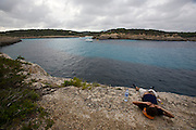 Tourist having a nap at Cala Mondrago.