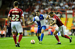 Bristol Rovers' Oliver Norburn holds off Bristol City's Marlon Pack  - Photo mandatory by-line: Dougie Allward/JMP - Tel: Mobile: 07966 386802 04/09/2013 - SPORT - FOOTBALL -  Ashton Gate - Bristol - Bristol City V Bristol Rovers - Johnstone Paint Trophy - First Round - Bristol Derby