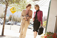 Businesspeople Walking Down Street