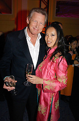 JOHN STEPHENS of China White and pianist ROSEY CHAN at a reception for the winners of the 2006 Veuve Clicquot Award - Business Woman of the Year held at Claridge's Hotel, brook Street, London on 27th April 2006.  This years winner was Vivienne Cox, BP CEO for Gas, Power, Renewables and Integrated Supply & Trading.  The awards were presented by the Rt.Hon.Gordon Brown MP - The Chancellor of the Exchequer.<br />