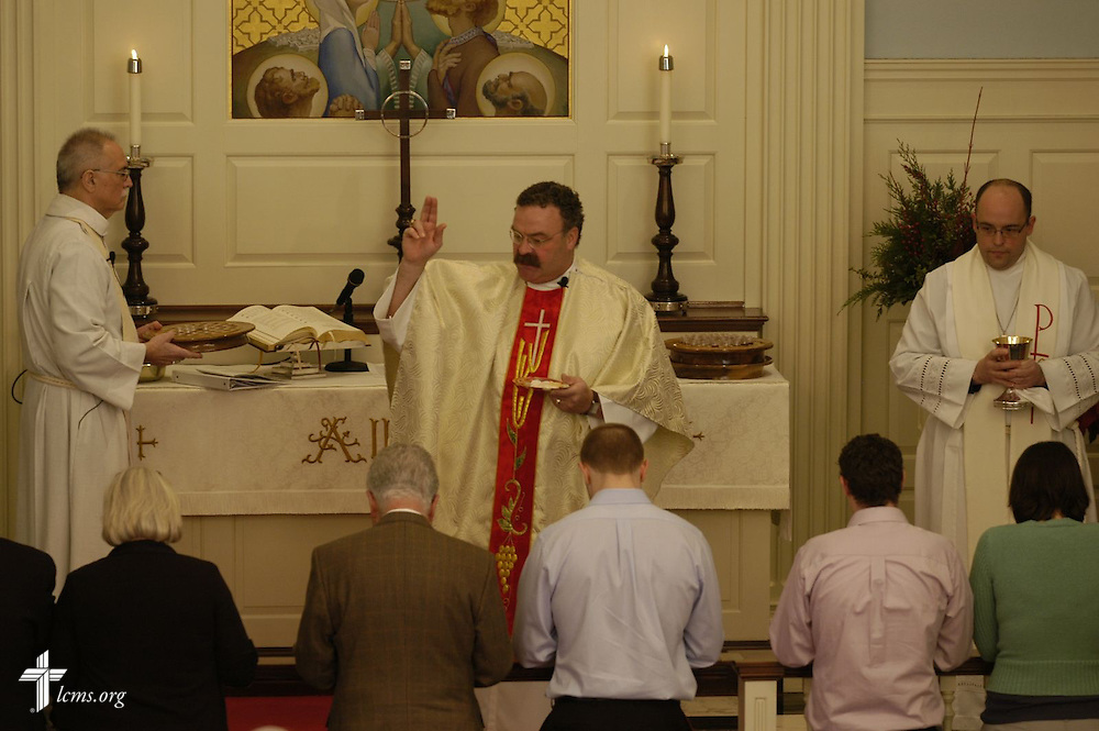 As his first official act as Village Lutheran Assistant Pastor, LCMS President Rev. Matthew C. Harrison leads the congregation through the service of the Sacrament.