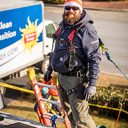 Revision Energy employee, Andrew Garneau, installing solar panels on a single family home in Lowell, Massachuetts.