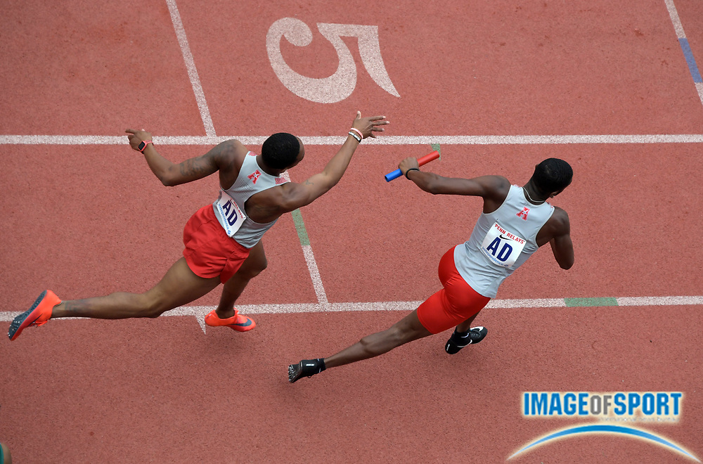 Apr 27, 2018; Philadelphia, PA, USA; Quivell Jordan takes the handoff from Amere Lattin on the first leg of the Houston 4 x 400m relay that won its heat in 3:08.62 during the 124th Penn Relays at Franklin Field.